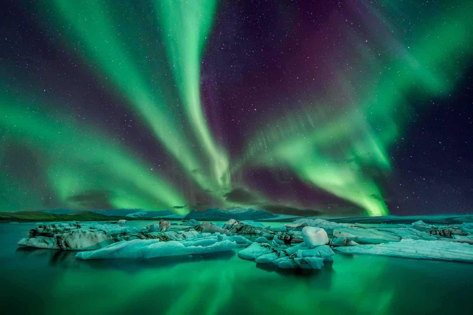 Fantastic Northern Lights Dancing in the dark skies over Jökulsárlón Glacier Lagoon in South East Iceland