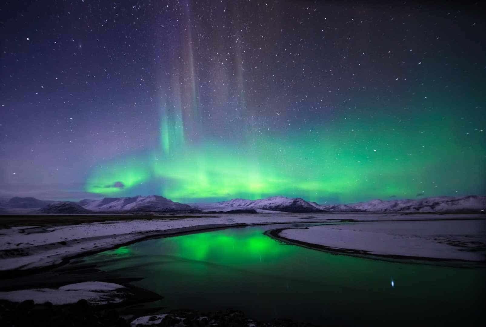 Beautiful Northern Lights Over Snow Covered Icelandic Landscape