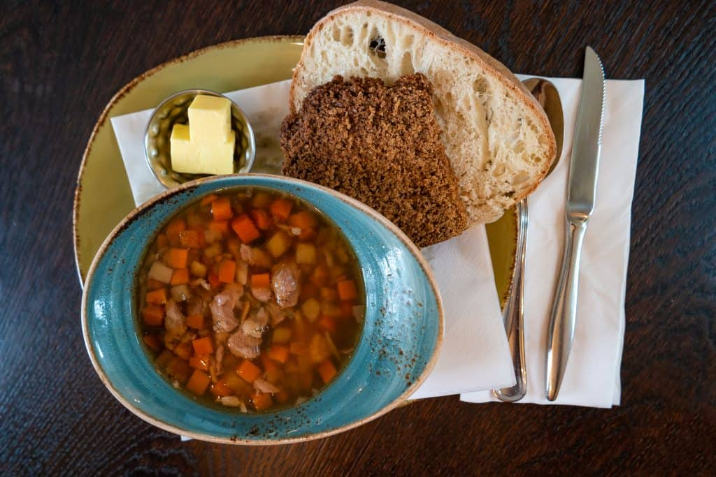Traditional Icelandic Lamb Soup Served With Bread And Butter Northern Lights Tour
