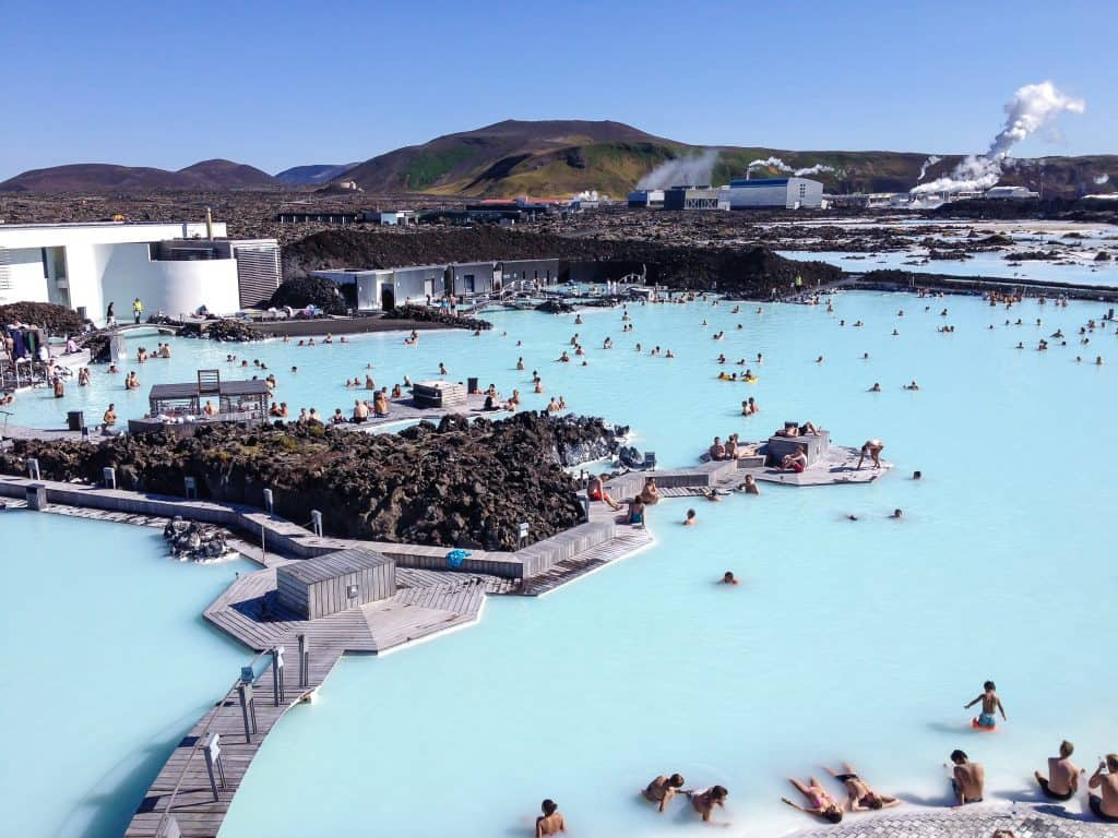 View Of People Bathing In The Blue Lagoon During A Private Luxury Transfer From Keflavik Airport To Reykjavik