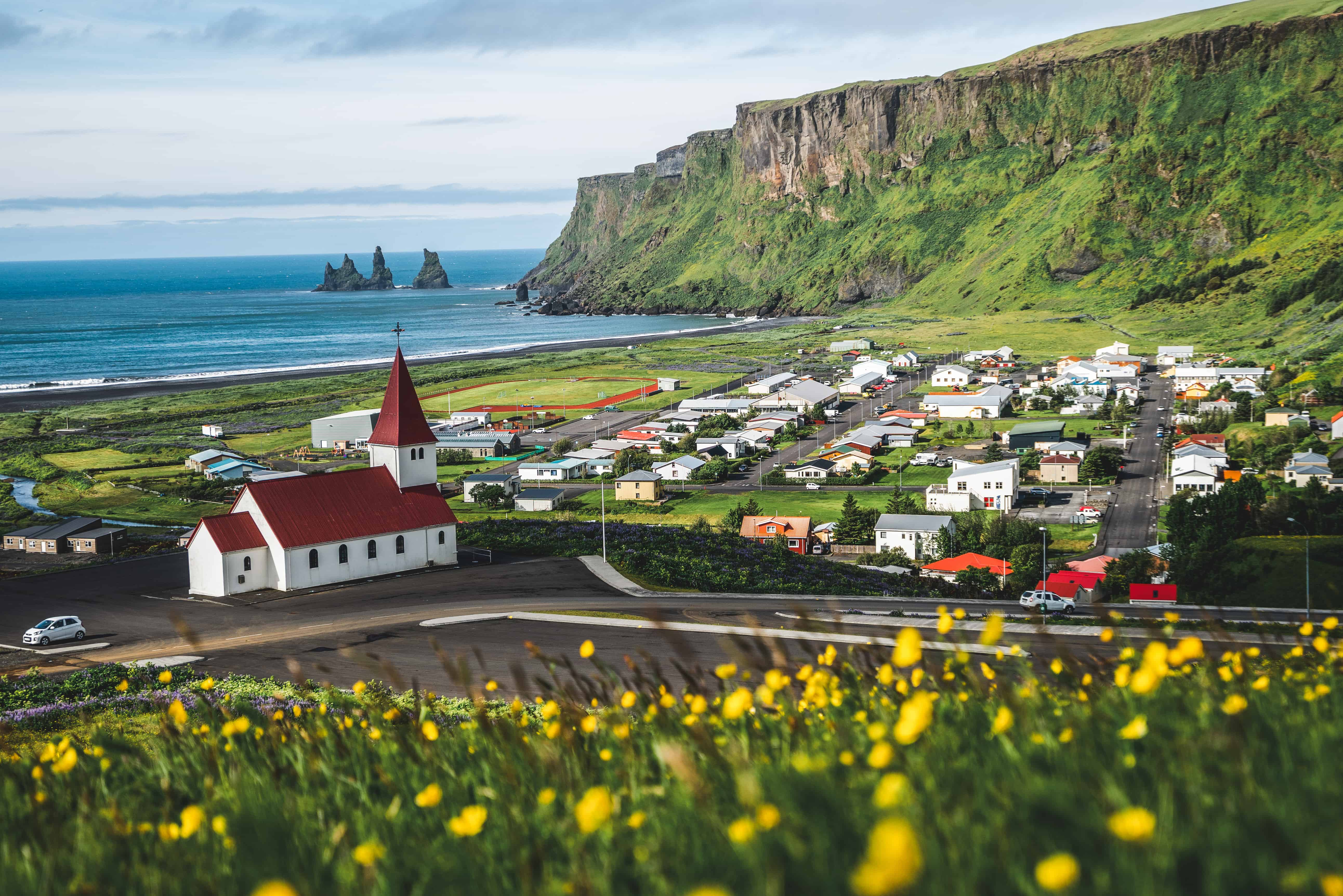 View Of Vík With The Wooden Church And The Sea Stack
